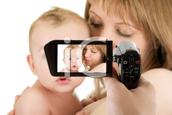 Royalty Free Photo of a Mother and Baby Being Filmed