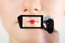 Royalty Free Photo of a Closeup of a Woman's Mouth Through a Camcorder
