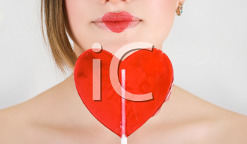 Royalty Free Photo of a Woman Holding a Heart Lollipop
