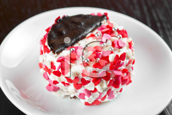 fresh baked cupcake with hearts on a wooden table