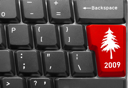 Close-up of computer keyboard with red Christmas tree key