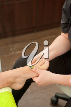 female foot massage in a beauty salon