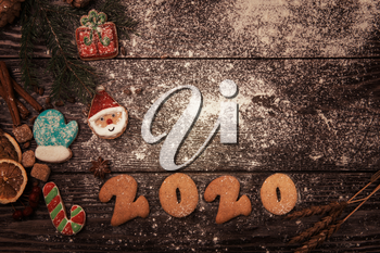 Different ginger cookies for new 2020 year holiday on wooden background, xmas theme
