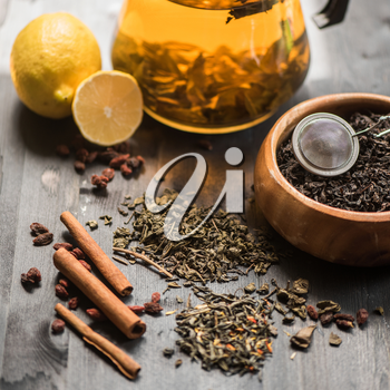 tea composition with cinnamon sticks, lemons