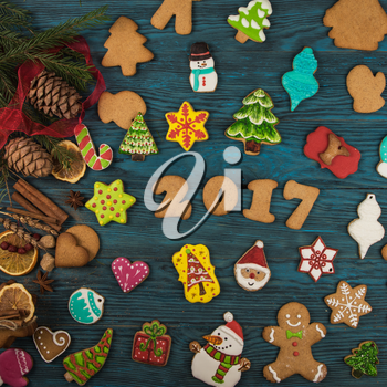 Gingerbreads for new 2017 year on wooden background, xmas theme