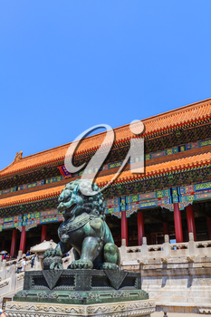 Beijing, China - April 29, 2015: Forbidden City, Beijing, China. The Gate of Supreme Harmony with guardian bronze lion