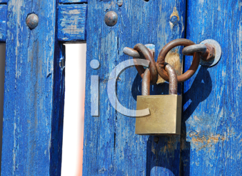 Royalty Free Photo of a Padlock on a Wooden Gate