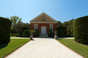 Royalty Free Photo of a Small Building on Landscaped Grounds