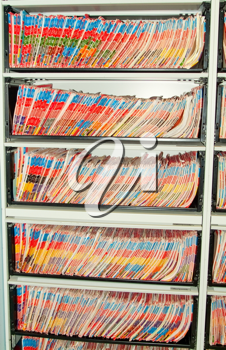 Medical Records folder archive organized in the file cabinet.