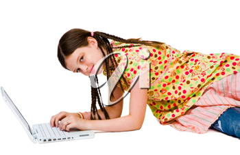 Royalty Free Photo of a Young Girl on the Floor Using a Laptop