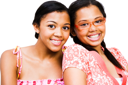 Portrait of two teenage girls smiling isolated over white