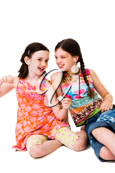 Happy girls listening to MP3 player isolated over white