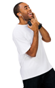 Smiling man listening to music on a MP3 player isolated over white
