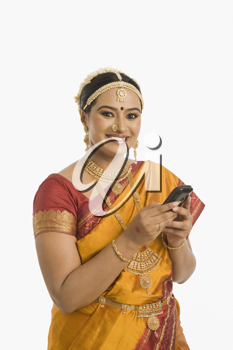 South Indian woman using a mobile phone