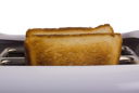 Close-up of a toaster with toasts