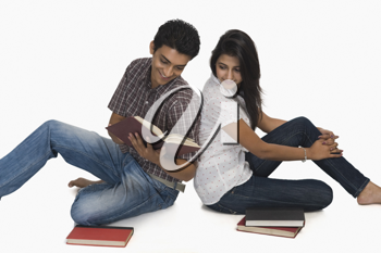 College students reading a book