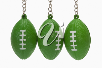 Close-up of American football shaped key rings