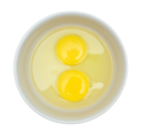 Royalty Free Photo of Two Raw Eggs in a Dish