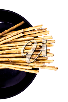 pile of pretzel sticks on white background.