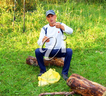 Man reposes on nature year daytime.Persons on nature