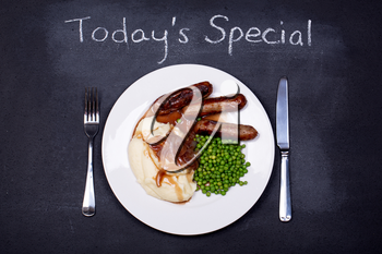 Chalkboard advertising the daily special of Sausages and Mash