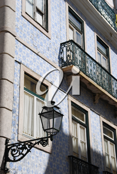 Royalty Free Photo of an Antique Building and Lamp in Lisbon, Portugal