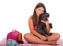 Royalty Free Photo of a Girl at the Beach With Her Dog