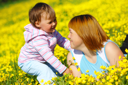 Royalty Free Photo of a Mother and Child in a Field of Flowers