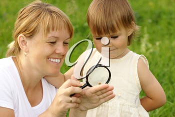 Royalty Free Photo of a Mother and Daughter Looking at a Snail Through a Magnifying Glass