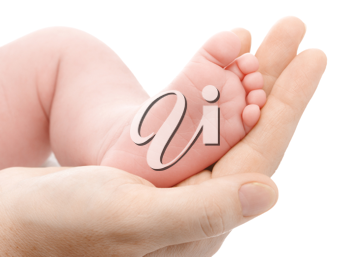 Royalty Free Photo of a Mother Holding a Newborn's Foot