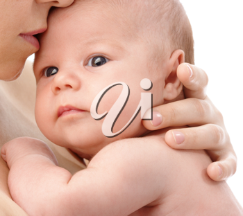 Royalty Free Photo of a Baby Held in Mother's Arms