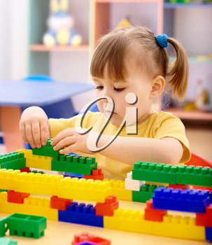 Royalty Free Photo of a Girl With Building Blocks