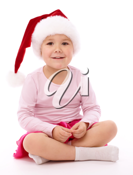 Royalty Free Photo of a Little Girl Wearing a Santa Hat