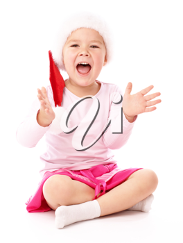 Royalty Free Photo of a Little Girl in a Santa Hat