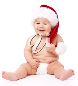 Royalty Free Photo of a Baby Wearing a Santa Hat