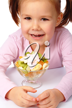 Royalty Free Photo of a Little Girl With a Fruit Salad