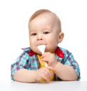 Royalty Free Photo of a Little Boy With a Plastic Spoon