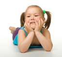 Royalty Free Photo of a Cute Little Girl Lying on the Floor