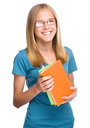 Young skinny student girl is holding exercise books, isolated over white