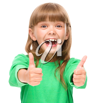 Little girl is showing thumb up sign using both hands, isolated over white