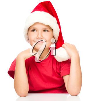 Portrait of a cute little girl in santa hat, isolated over white