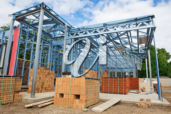 New home under construction using steel frames against a blue sky