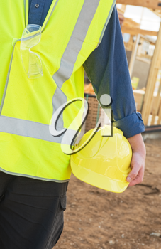 A young worker at the construction site with safety equipment