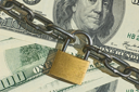 Financial security concept imageone hundred dollars locked  with padlock