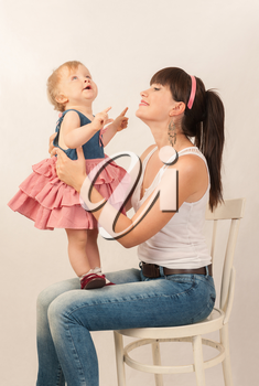 young happy mother with baby daughter in retro toning