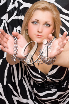 Royalty Free Photo of a Woman With Her Hands in Chains