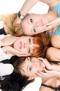 Royalty Free Photo of Three Women With Their Heads Together