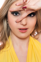 Royalty Free Photo of a Woman Forming a V Around Her Eye With Her Fingers