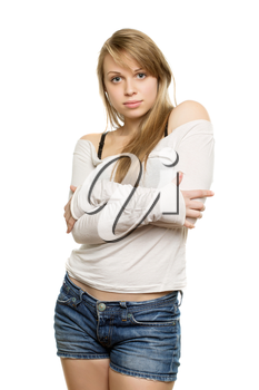 Charming young woman in white blouse hugging herself. Isolated