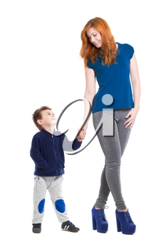 Pretty smiling woman posing with a little boy. Isolated on white